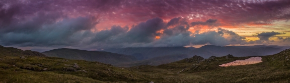 Sunrise and the sky over the Lake District explodes into colour.